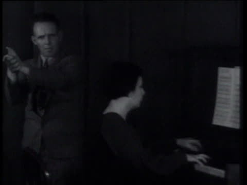 vídeos y material grabado en eventos de stock de march 20, 1935 ms man plays hands to tune of let me call you sweetheart, accompanied by piano / traverse city, michigan, united states - 1935