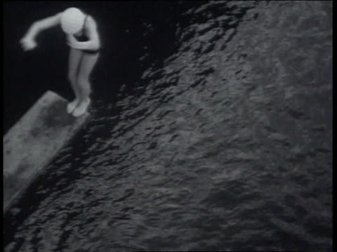 march 20, 1939 ha diving off high dive board into swimming pool / miami, florida, united states - tuffarsi video stock e b–roll