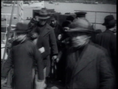 vidéos et rushes de march 20 1939 montage people walking through line and being searched by military personnel / shanghai china - caméra tremblante