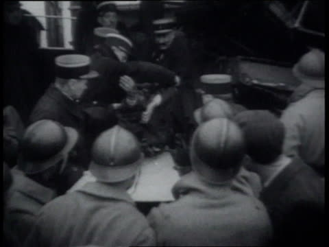 march 20 1939 montage rescue workers pulling victims from rubble of train wreck / chateauroux france - wackelaufnahme stock-videos und b-roll-filmmaterial