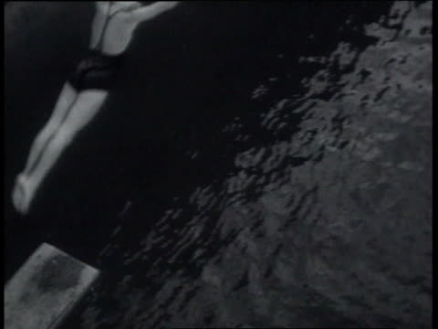 march 20, 1939 ha swan dive off high dive board into swimming pool / miami, florida, united states - swimming cap stock videos & royalty-free footage
