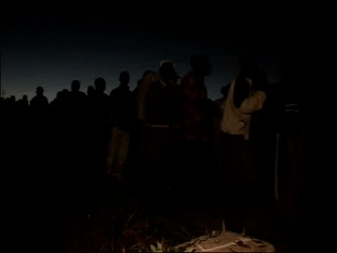 march 2008 montage people queuing at night for voting during zimbabwean presidential election/ men standing by sign for polling station/ group of men... - western script stock videos & royalty-free footage
