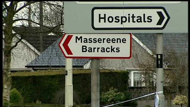massereene barracks exterior of massereene barracks road sign for massereene barracks pull out to police cordon - barracks stock videos & royalty-free footage