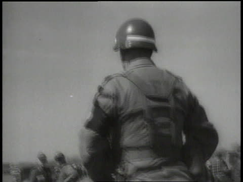 March 21 1965 MONTAGE Military police watch as marchers walk peacefully / Selma Alabama United States