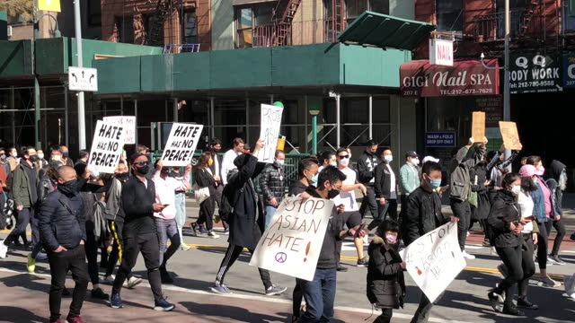 march 21: stop the asian hate hundreds rally in union square against anti-asian violence manhattan new york city ny usa on march 21 2021 stop the... - asian and indian ethnicities stock videos & royalty-free footage
