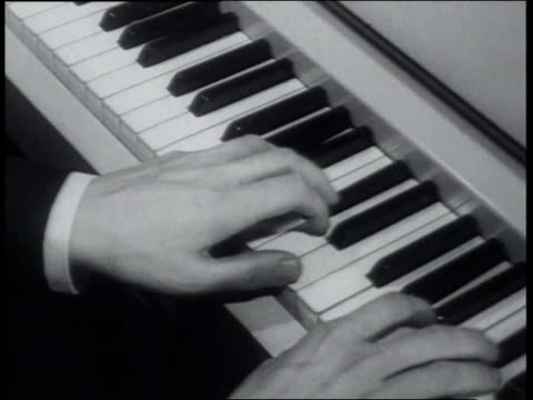 vidéos et rushes de march 22, 1939 man's hands playing keyboard with carillon bells sound - piano