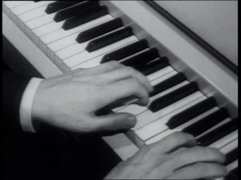 vidéos et rushes de march 22, 1939 man's hands playing keyboard with carillon bells sound - image en noir et blanc