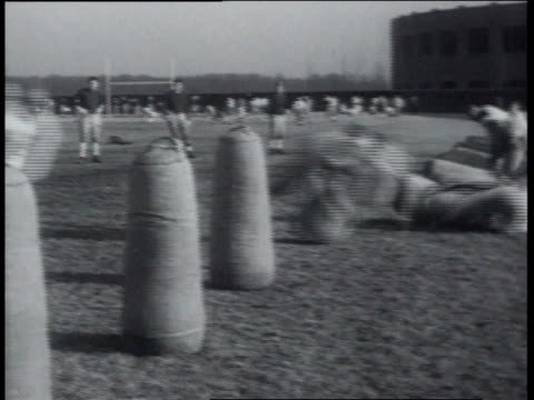 march 22, 1939 montage notre dame players in training / south bend, indiana, united states - ゴールポスト点の映像素材/bロール