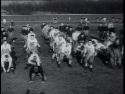 march 22, 1939 notre dame football squad working out / south bend, indiana, united states - 1939 stock videos & royalty-free footage