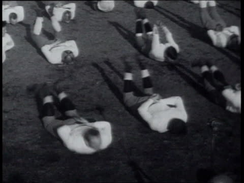 march 22, 1939 notre dame football squad working out / south bend, indiana, united states - 1939 stock-videos und b-roll-filmmaterial