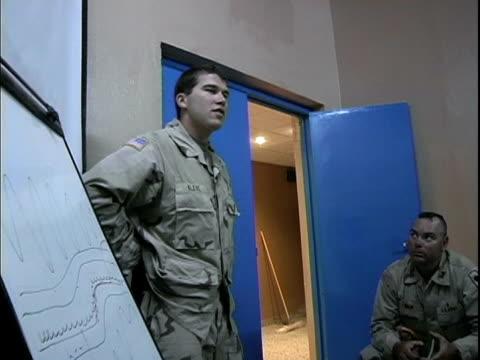vídeos y material grabado en eventos de stock de march 24 2004 eod specialist explaining what ied is, baghdad, iraq, audio - encuadre de tres cuartos