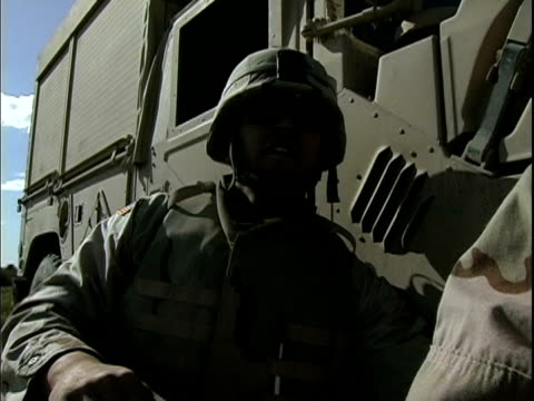 march 25 2004 montage eod specialist detonating roadside bomb and explaining what he has done, baghdad, iraq, audio - one mid adult man only stock videos & royalty-free footage