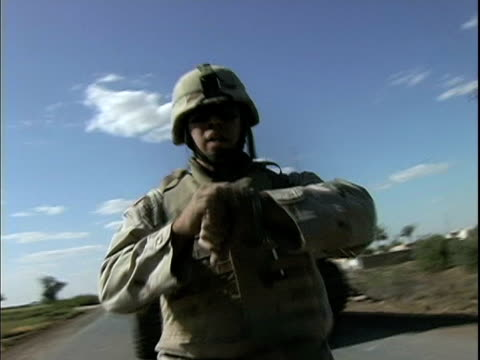 march 25 2004 montage soldier jumping off tank and pointing at explosion in distance, baghdad, iraq, audio - one mid adult man only stock videos & royalty-free footage