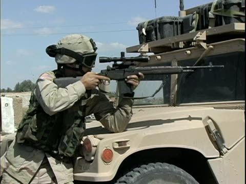 march 25 2004 montage soldiers patrolling streets, baghdad, iraq, audio - one mid adult man only stock videos & royalty-free footage