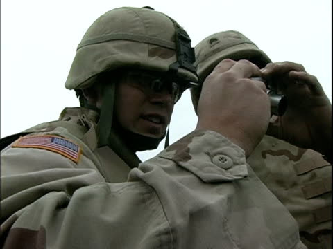 march 27 2004 soldiers looking at digital camera, baghdad, iraq, audio - only mid adult men stock videos & royalty-free footage