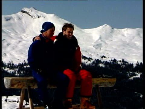 March 28 2004 FILM MONTAGE Prince William skiing/ WS Prince Charles and Prince William skiing and coming to a stop/ MS Paparazzi taking photos/ MS...