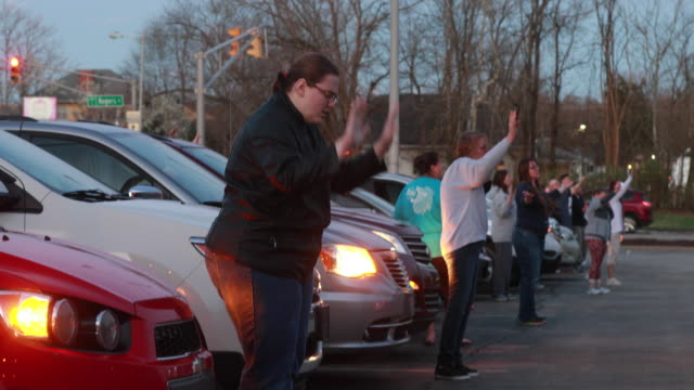march 29, 2020 - bloomington, indiana usa: a group of community members from the lighthouse fellowship church in gosport, ind., gather sunday night... - praying stock videos & royalty-free footage