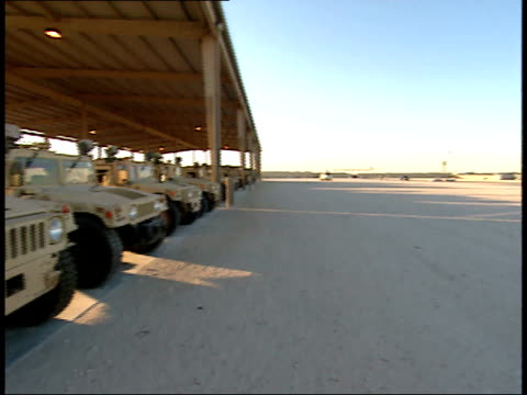 March 31 1999 MONTAGE Row of parked Humvees and other military vehicles at As Saliyah Army Base / Doha Qatar
