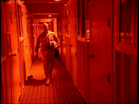 march 31, 1999 u.s. army soldier walking down hallway and entering living quarters in as saliyah army base / doha, qatar - camp as sayliyah bildbanksvideor och videomaterial från bakom kulisserna