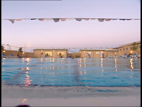 march 31, 1999 u.s. army soldiers swimming laps in outdoor pool / doha, qatar - camp as sayliyah bildbanksvideor och videomaterial från bakom kulisserna