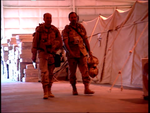 march 31, 1999 u.s. army soldiers walking through interior of tented area / doha, qatar - camp as sayliyah bildbanksvideor och videomaterial från bakom kulisserna