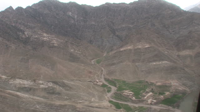 march 5 2009 aerial korengal valley's rocky terrain / afghanistan - korengal valley stock videos & royalty-free footage