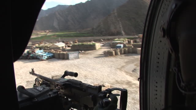 March 5 2009 AERIAL US Army soldier manning machine gun as helicopter takes off / Kunar Afghanistan