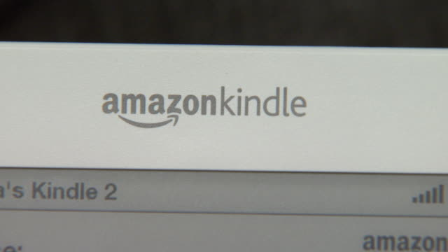 march 5 2009 cu amazon kindle 20 being demonstrated by man's hands / united states - kindle stock videos & royalty-free footage