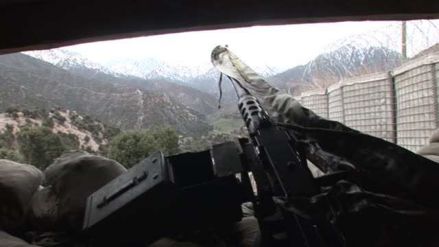 march 5 2009 pov peering from inside bunker out to hillside over machine gun barrel / kunar afghanistan - korengal valley stock videos & royalty-free footage