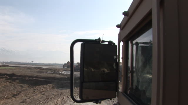 march 5, 2009 shaky u.s. army armored vehicles driving across muddy, barren land / bagram, afghanistan - bagram stock videos & royalty-free footage
