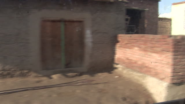 stockvideo's en b-roll-footage met march 5 2009 pov us army armored vehicles in convoy driving through village / bagram afghanistan - bagram