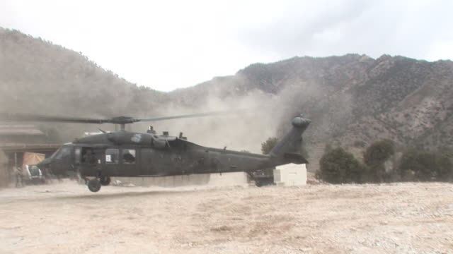 march 5 2009 ts us army helicopter landing in the field / afghanistan - korengal valley stock videos & royalty-free footage