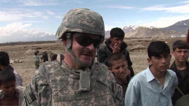 march 5, 2009 u.s. army soldiers speaking and playing with children / bagram, afghanistan - bagram stock videos & royalty-free footage