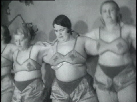 stockvideo's en b-roll-footage met march 6, 1935 montage overweight women dancing in lingerie on a stage / chicago, illinois, united states - ondergoed