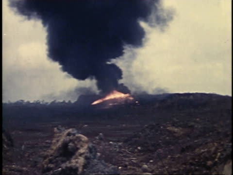march 6 1945 ws flamethrowing tank attacking enemy position on iwo jima / japan - schlacht um iwojima stock-videos und b-roll-filmmaterial