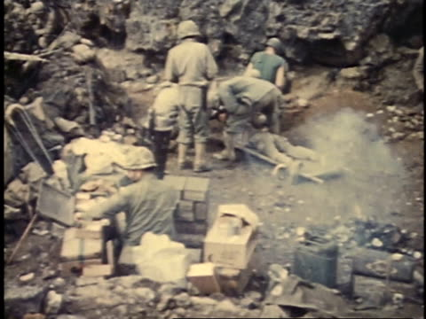 march 6, 1945 montage medics treating wounded soldier on iwo jima / japan - battaglia di iwo jima video stock e b–roll