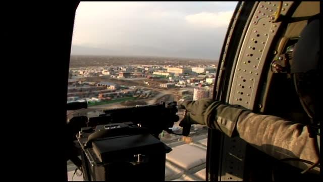 march 6, 2009 aerial soldier securing machine gun as gunship lands / bagram, afghanistan - bagram stock videos & royalty-free footage