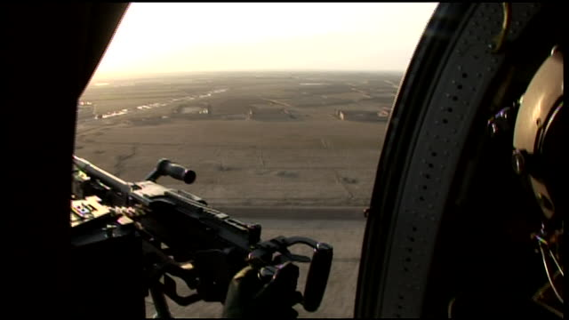 march 6, 2009 aerial soldiers manning guns aboard helicopter / bagram, afghanistan - bagram stock videos & royalty-free footage