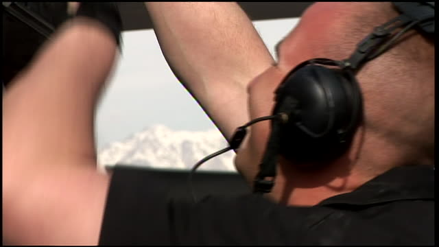 march 6 2009 montage us air force mechanic attending to fighter jet on airfield tarmac / bagram afghanistan - ohrenschützer stock-videos und b-roll-filmmaterial