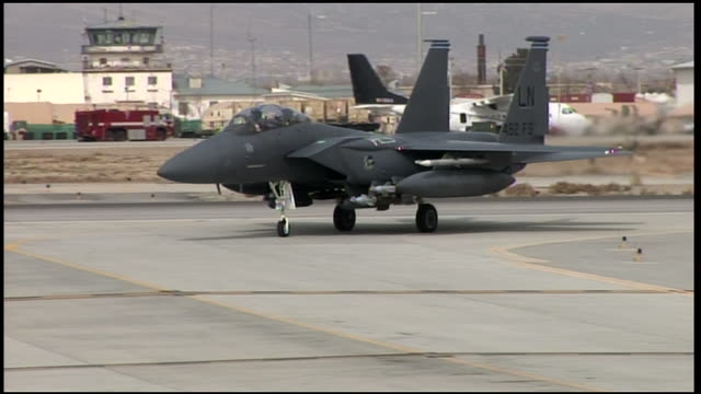 march 6 2009 ts two us air force fighter jets taxiing on a runway / afghanistan - taxiway stock videos & royalty-free footage