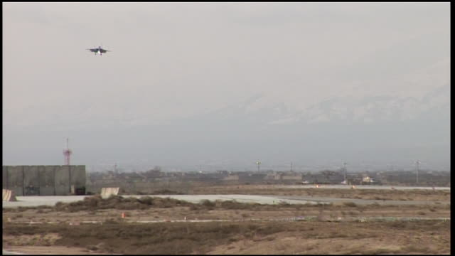 march 6 2009 ts us air force fighter jet landing on a runway past parked military aircraft / bagram afghanistan - military base stock videos & royalty-free footage