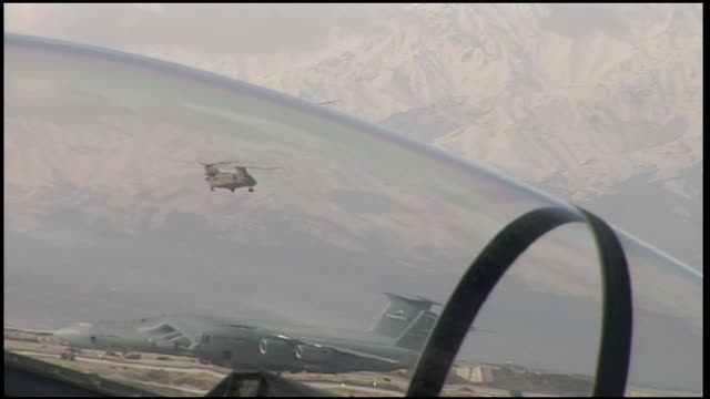 march 6 2009 ts us air force helicopter flying and landing next to parked fighter jets / bagram afghanistan - bagram air base stock videos & royalty-free footage