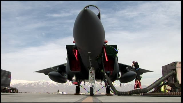 march 6, 2009 u.s. air force mechanic attending to fighter jet on airfield tarmac / bagram, afghanistan - bagram stock videos & royalty-free footage