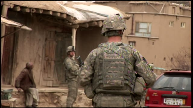 march 6 2009 ms us army soldier standing guard in village street as a unit assembles for patrol / afghanistan - 2009 stock videos & royalty-free footage