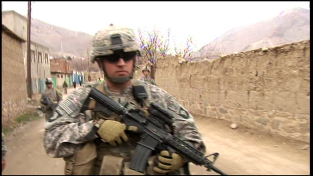 march 6, 2009 u.s. army soldiers on patrol in village street discussing insurgent activity / bagram, afghanistan - bagram stock videos & royalty-free footage