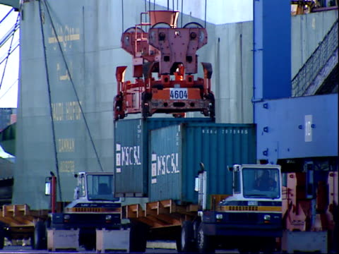 march 7 2006 td containers being loaded onto a truck at the port of baltimore and the truck driving away / maryland united states - port of baltimore stock videos & royalty-free footage