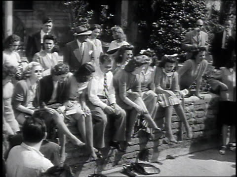 march 8, 1946 montage women trying on free nylons / hollywood, california, united states - tights stock videos & royalty-free footage