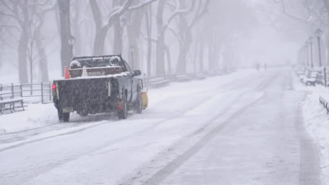 march 8 2013 snow storm blizzard central park utility vehicles plowing snow midtown manhattan new york city usa 2013 snow storm snow plowing central... - 2013 stock videos & royalty-free footage