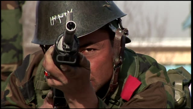 march 9 2009 cu afghan national army recruit aiming his rifle / afghanistan - afghan national army stock videos & royalty-free footage