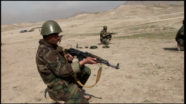 march 9, 2009 afghan national army recruits being instructed in infantry advancing techniques and lying prone to aim and fire / afghanistan - afghan national army stock videos & royalty-free footage